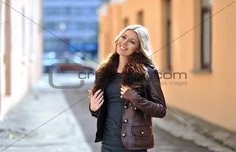 Casual urban portrait of happy woman outdoor