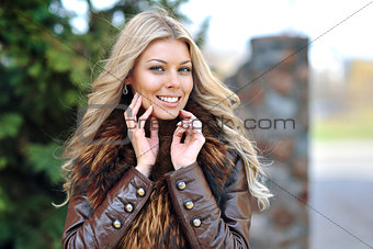 Close up of a beautiful blonde woman portrait - outdoor