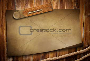 old paper ruler and rope on wooden table