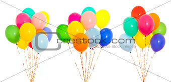 colourful balloons bunches filled with helium isolated on white