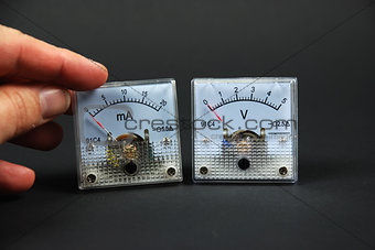 old and analog current and voltage meters