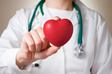 Heart in doctor&#39;s hand