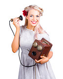Woman using antique telephone