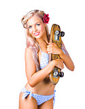 Woman in bikini holding skateboard