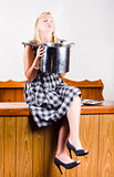 Woman holding hot cooking pot in kitchen