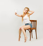 Blonde Woman Taking Self Portrait with Phone