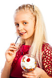 Beautiful blond girl eating dessert