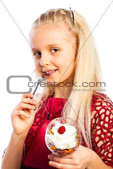 Beautiful blond girl eating dessert
