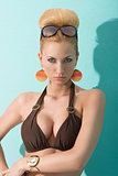 portrait of blonde lady in bikini with sunglasses