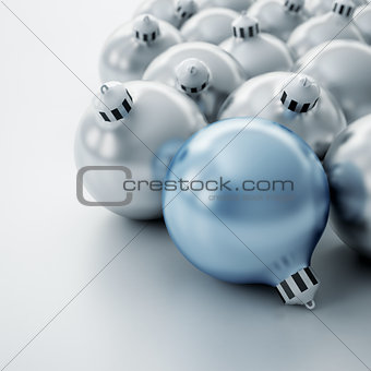 Christmas balls of silver and blue color on a white background
