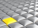 abstract smooth grey metallic cubes with a contrasting yellow cube