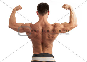 Rear view of a young man flexing his arm and back muscles over white