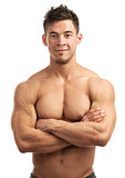 Portrait of a handsome young man with great physique posing against white background