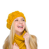 Smiling girl in autumn clothes looking on copy space