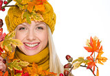 Girl in hat and scarf with autumn bouquet