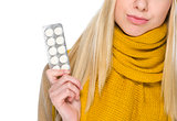 Closeup on girl holding pills pack