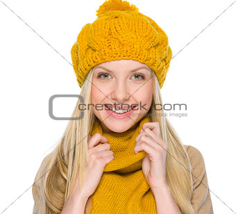 Portrait of happy girl in autumn clothes
