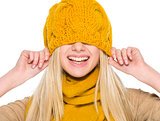 Smiling girl in autumn clothes with hat over head