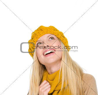 Portrait of smiling girl in autumn clothes looking up on copy sp