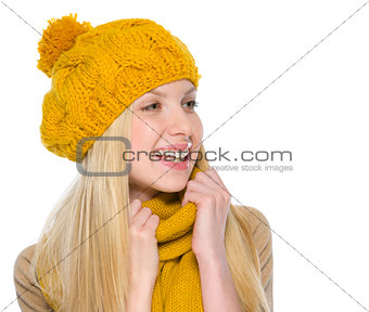 Portrait of smiling girl in autumn clothes looking on copy space