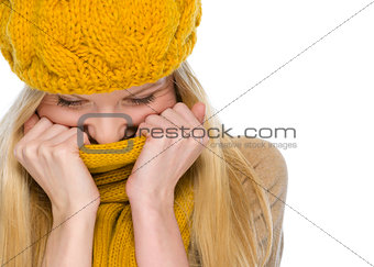 Portrait of happy girl in autumn clothes wrap up in scarf