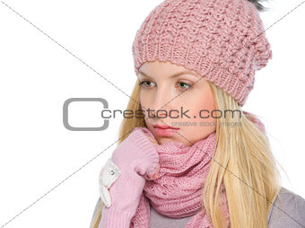 Portrait of thoughtful girl in winter clothes