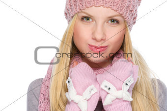 Portrait of funny girl in winter clothes