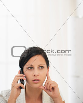Concerned young woman talking mobile phone