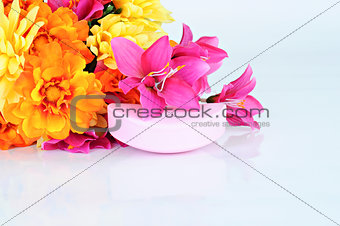Rose soap and flowers on white background
