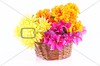 Colorful flowers in wooden basket