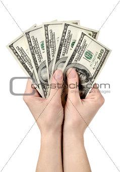 Hands holds hundreds of dollars
