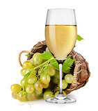White wine and  grapes in a basket
