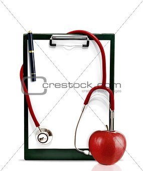 Stethoscope with a clipboard and a red apple