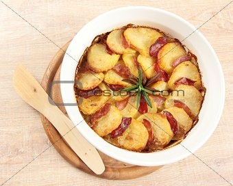 potato casserole with rosemary twig