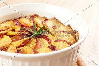 potato casserole with rosemary twig