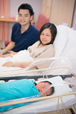 Asian Newborn and parents