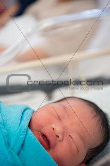 Asian Newborn Baby smiling