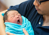 Asian father and newborn baby
