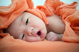 Newborn Asian baby girl awake,