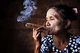 Old Asian woman smoking 