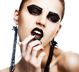 Individuality. Expression. Face of Extraordinary Ultramodern Hippie with Extreme Make-up. Subculture