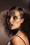 Futurism. Bodyart. Golden Painted Woman&#39;s Skin with Silver Accessory. Art Deco