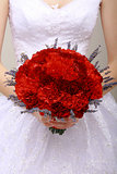 Donation. Compliment.Vernal Bouquet of Red Flowers in Woman's hands. Felicitation
