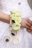 Arrangement. Bouquet of Flowers as a Bracelet on Woman's Hands. Floristics