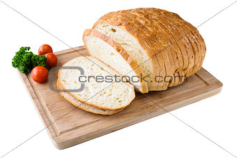 Sliced white bread on the wooden board with tomatos