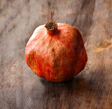 Vintage background with old dry pomegranate