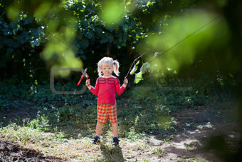 child with secateurs
