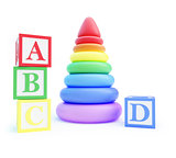 pyramid toy and alphabet blocks