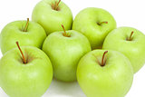 seven green apples isolated on a white background 