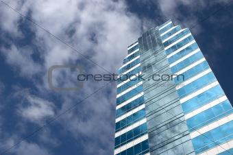 Blue skyscraper in blue sky